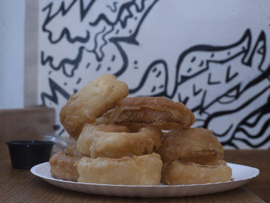 Beer Battered Onion Rings are served with Buttermilk