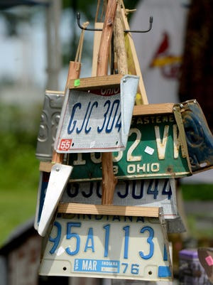Expired license plates are recycled into dust pans at one Centerville, Ind., vendor's spot June 3, 2016, along the Historic National Road Yard Sale route.