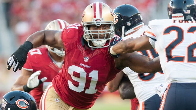 San Francisco 49ers defensive end Ray McDonald (91) attempts to tackle Chicago Bears running back Matt Forte (22) during the second quarter at Levi's Stadium. The Chicago Bears defeated the San Francisco 49ers 28-20.