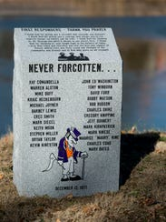 The memorial marker is seen after its unveiling during