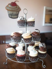 Cupcakes are arranged in a tower at Butter Cream Cupcakery
