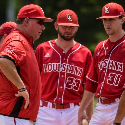 UL head coach Tony Robichaux, center, and his Ragin' Cajuns are going to Troy, Ala., with the mentality that they need to win the Sun Belt Conference Tournament.