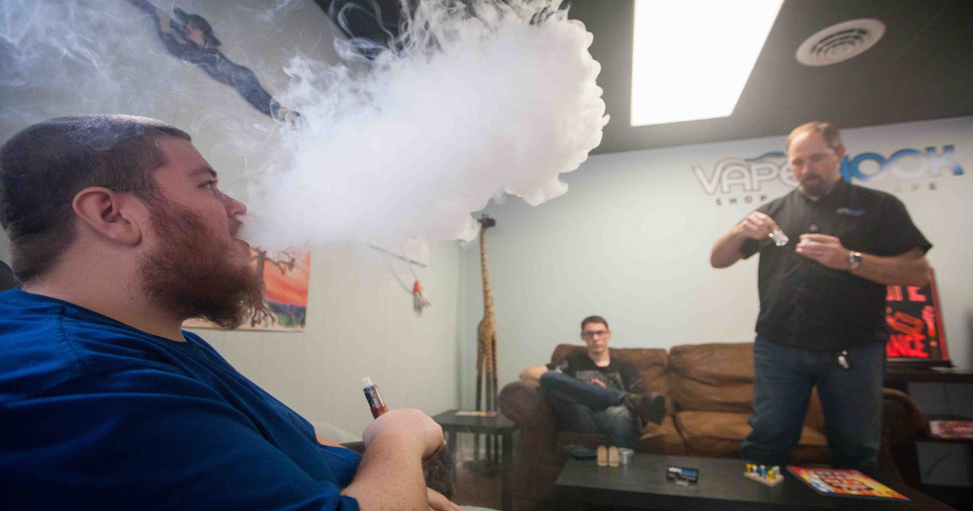 Vape shop owners, customers fight indoor ban on e-cigs