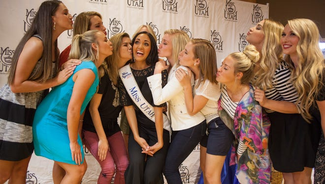Miss Utah 2015 Krissia Beatty meets with friends and family at a celebration at Dixie State University shortly before she begins her trip to Miss America Saturday, Aug. 22, 2015.