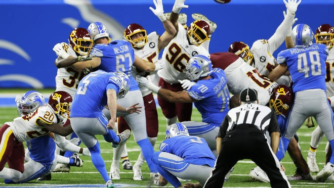 Detroit Lions kicker Matt Prater (5) boots the winning field goal with seconds remaining during the second half of an NFL football game against the Washington Football Team, Sunday, Nov. 15, 2020, in Detroit.