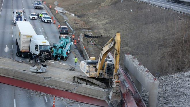 A semi-tractor trailer is removed from the scene of the old Hopple Street overpass collapse on January 20, 2015.