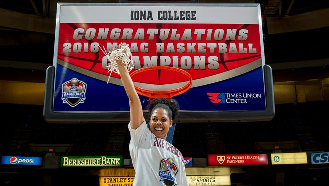 Iona women's basketball coach Billi Godsey cuts down the net after her team's MAAC tournament championship at the Times Union Center in Albany on March 7, 2016.