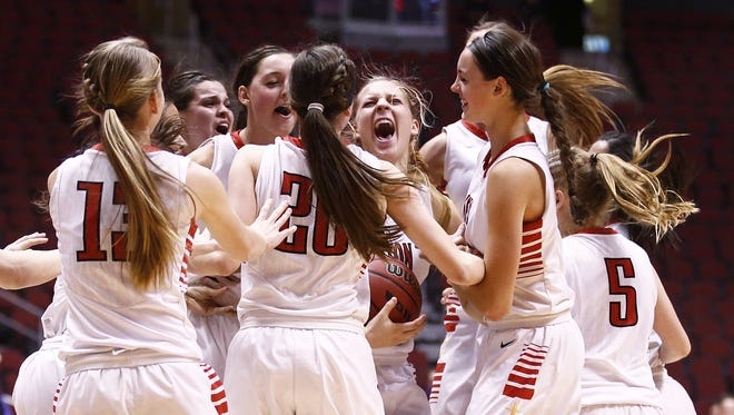 Seton Catholic Prep celebrates after defeating Cactus Shadows during the Division II girls championship game in Glendale, Ariz., on Monday, February 29, 2016.