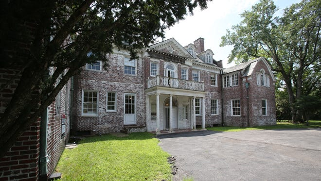 A view of the exterior of the 1920s Colonial mansion in Purchase. The New York State, which owns the property, auctioned off the house last year, but the sale of the property didn't go through, and the house is on the market again. Another auction is expected this fall.