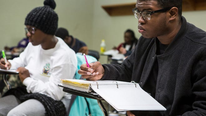 March 14, 2017 - Courtney Harris, a first-year education major, takes notes in Ronald Alexander's Math 110: Concepts of Algebra class at LeMoyne-Owen College. By 2022, African-American and Latino students are expected to make up nearly 55 percent of all public school students.
