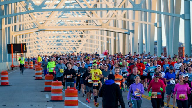 Participants run over the Taylor-Southgate Bridge into Newport during the 19th Flying Pig Marathon Sunday, May 7, 2017.