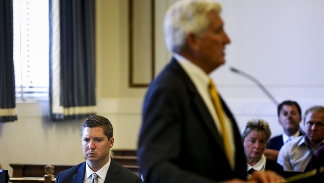 Ray Tensing, the former University of Cincinnati police officer, listens to Stew Mathews present closing arguments on the eighth day of Raymond Tensing's retrial in Hamilton County Common Pleas Judge Leslie Ghiz's courtroom Monday, June 19, 2017.