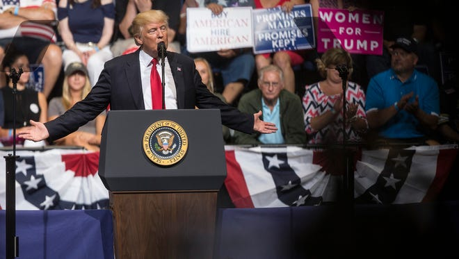 President Donald Trump speaks to a crowd of people inside the US Cellular Center during a rally on Wednesday, June 21, 2017, in Cedar Rapids.