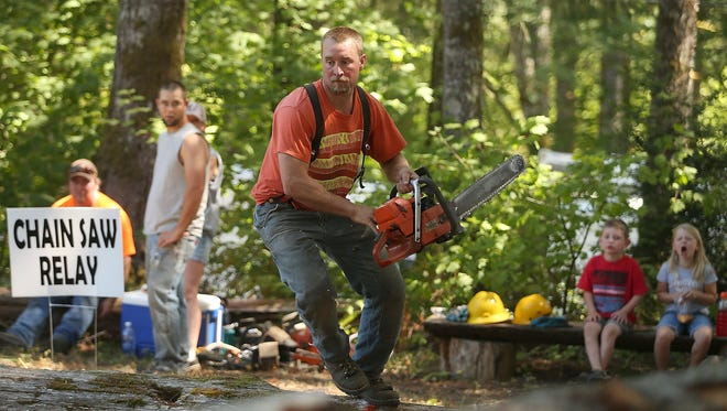 Joe Emel, of Seabeck, participates in the chainsaw relay during the 2016 Crosby Days.