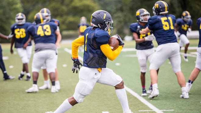 Eric Gray runs with the ball during Lausanne Collegiate School's football practice Sept. 6, 2017.