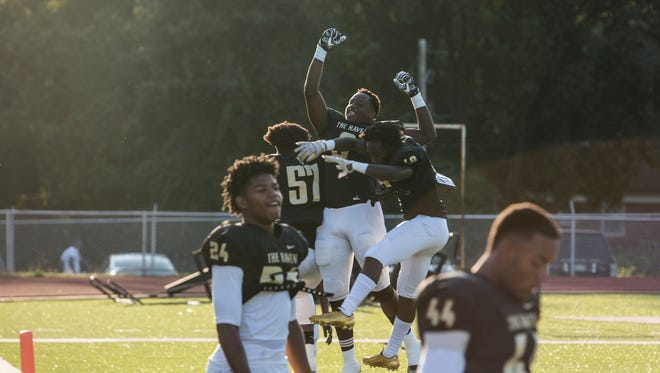 September 08, 2017 - Whitehaven football players get pumped up before the start of Friday night's game versus Lausanne Collegiate School at Whitehaven High School.