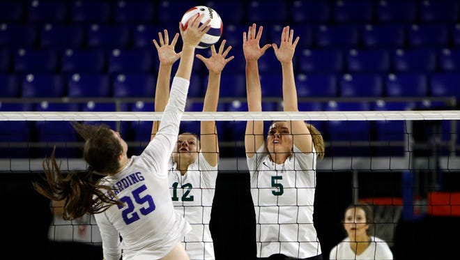 Bailey Musrock and Kayleigh Hames of Webb go up for the block during the Division II-A state volleyball championship last season.