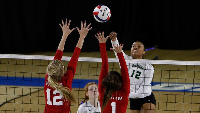 Briarcrest's Alyiah Wells goes for the spike against Chattanooga Baylor during the TSSAA Division II-AA state volleyball championship Thursday at MTSU's Murphy Center.