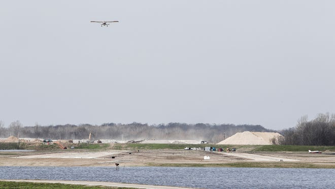 March 09, 2018 - An airplane takes off as water continues to rise near General DeWitt Spain Airport after pump failures at a neighboring treatment plant.