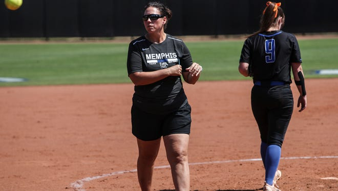 April 28, 2018 - Coach Natalie Poole tosses the ball back to the umpire after taking with Molly Smith, pitcher, during a University of Memphis softball game versus Tulsa. Memphis went on to defeat Tusla 3-0.