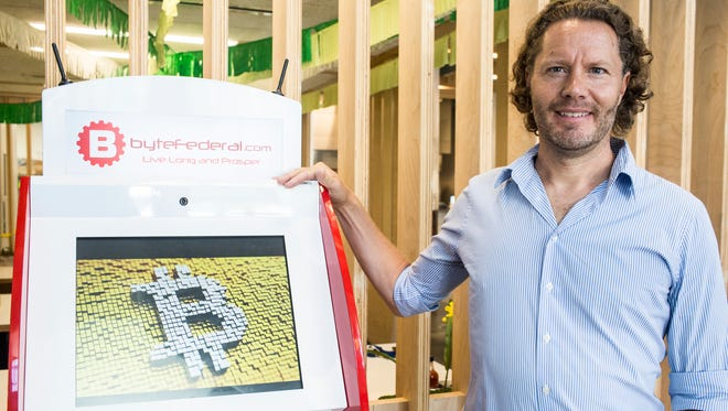 July 17, 2018 - Philipp von Holtzendorff-Fehling, chief executive and co-founder of Mama Gaia, stands with a Byte Federal Bitcoin ATM that is located inside of his restaurant at Crosstown Concourse.