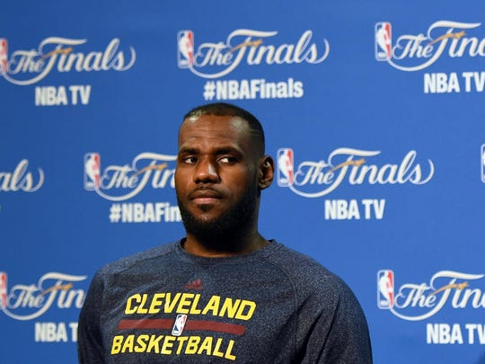 The Cavaliers' LeBron James answers questions at a news conference Wednesday at Quicken Loans Arena in Cleveland.