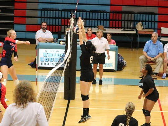 Lexi Smith blocks the ball from an outside hitter.