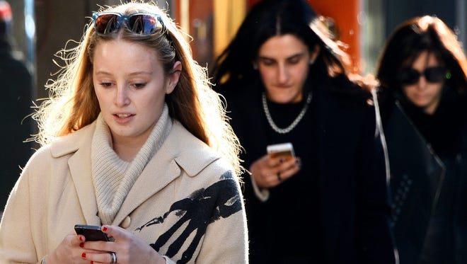 Two women use their cell phone in New York.