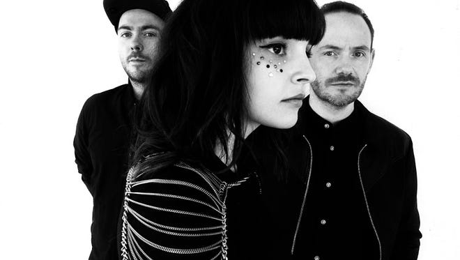 Martin Doherty, left, Lauren Mayberry and Iain Cook of Glasgow band Chvrches.