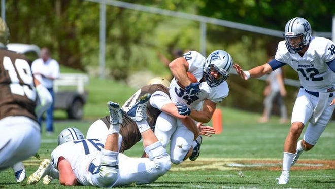 Monmouth University running back Zach Welch finishes a first-half run on Saturday against Lehigh. The Hawks won, 23-21.