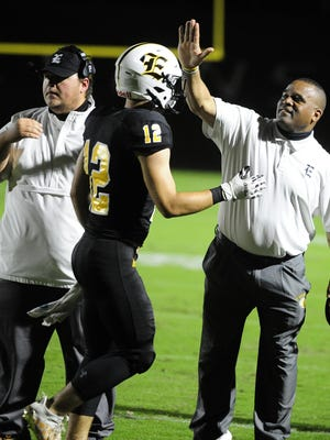 Evans Head Coach Lemuel Lackey, right, congratulates Reid Atkins after a score in the first half against Harlem at the high school football game between Harlem and Evans on Sept. 18, 2020 in Evans, Ga.