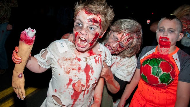 A group of young zombies participates in the sixth annual Zombie Walk on Saturday in downtown Las Cruces.