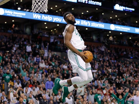 Boston Celtics guard Jaylen Brown (7) drives to the