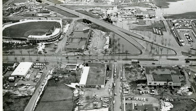 Roosevelt Road came fed its traffic onto Division Street at an angle right where Division Place Fashion now stands. The Roosevelt-Division intersection is on the right side of this 1960 photo. Also, seen in the photo: Municipal Stadium, Miller Shopping Center and Swiggum's Motel & Cafe on the south side of Division Street, and Unger Motors, Feddema's City Services, Holes-Webway and Coca-Cola Bottling Co. on the north side.