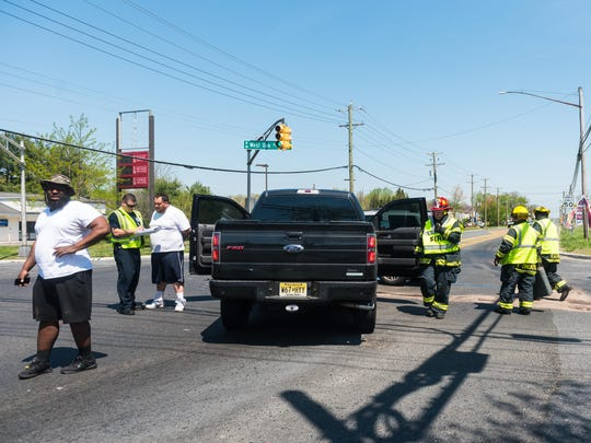 Vineland firefighters clean up after a two car accident at Delsea Drive and W Oak Road on Thursday, May 4.