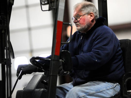 Warehouse worker Randy Dolgner of Sheboygan operates a forklift as he helps load freight for delivery by Wisconsin in Two Rivers.