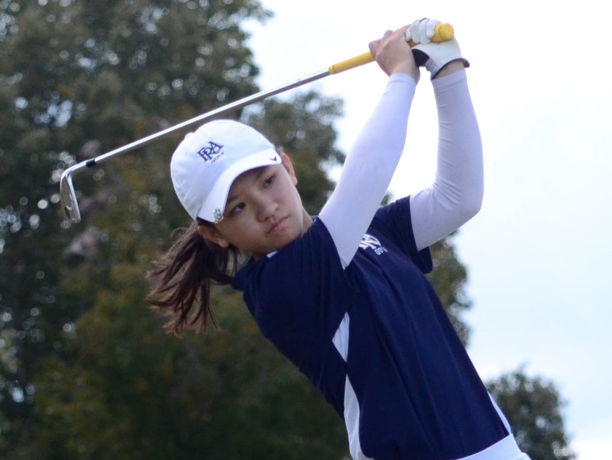 FRA's Angelina Chan watches her tee on hole No. 17.