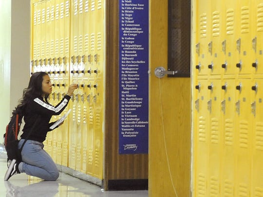 A student opens her locker at Fernley High School on the first day of school.