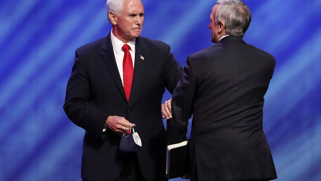Vice President Mike Pence, left, greets Senior Pastor Dr. Robert Jeffress, right, after Pence spoke at the Southern Baptist megachurch First Baptist Dallas during a Celebrate Freedom Rally in Dallas, Sunday, June 28, 2020.