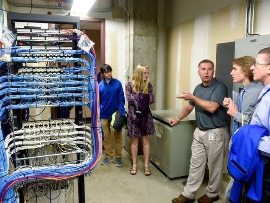 Cathedral High School students take a tour while learning about computer science careers from members of the Stearns County information services department at the county government center Tuesday, Oct. 17, in St. Cloud.