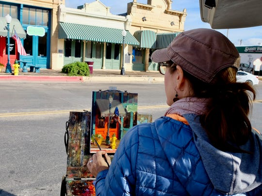 Suzie Baker of Texas paints during Quick Draw for the 2016 EnPleinAirTEXAS.