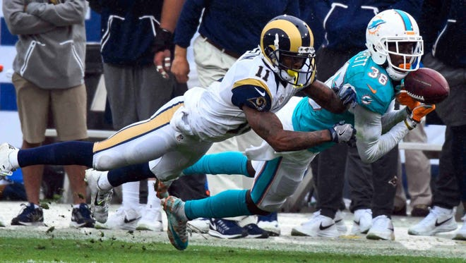 Former Michigan State standout Tony Lippett, right, tore his Achilles on Monday and will miss the entire 2017 season for the Miami Dolphins.