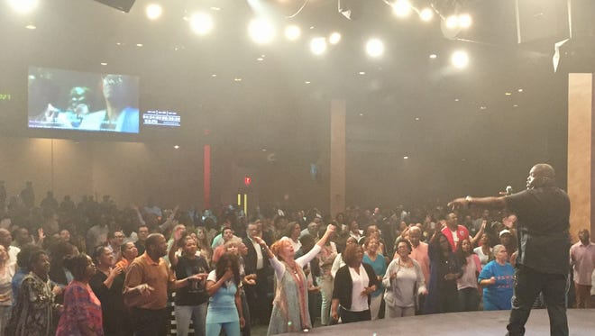 Gospel musician William McDowell leads thousands at Prayerfest.