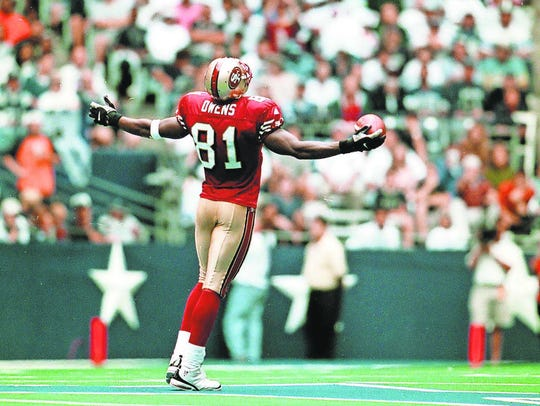 San Francisco's Terrell Owens celebrates in front of