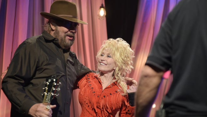 """Hank Williams Jr. and Dolly Parton share a moment at the pre-taping for the """"Dolly Parton's Smoky Mountains Rise: A Benefit for the My People Fund"""" Tuesday, Dec. 13, 2016, in Nashville, Tenn."""
