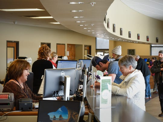 Drivers renew their tabs and licenses Friday, March 2, at the Stearns County Service Center in Waite Park.