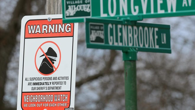A neighborhood watch sign is posted at the corner of Lonview Avenue and Glenbrooke Lane in Allouez. Village leaders hope neighborhood watch groups will help spark the creation of neighborhood associations.