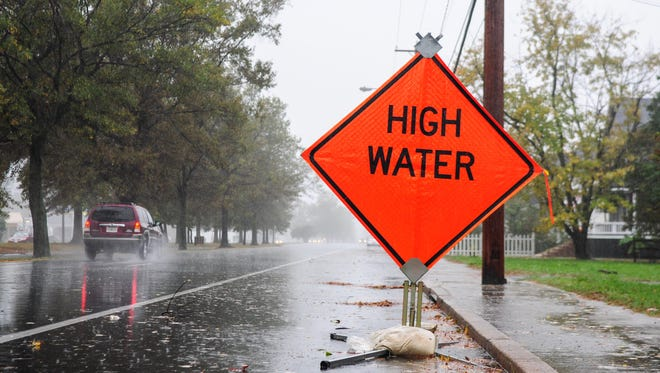 A High Water sign is placed on 413 in Crisfield to warn drivers as the high tide comes in on Monday afternoon during Hurricane Sandy. Patricia Hildenbrand photo
