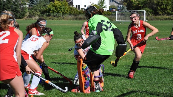 Fox Lane goalie Grace Kiernan stops Caitlin Lynch as Kerri Gutenberger (13) looks for rebound.
