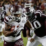 Mississippi State wide receiver Malik Dear (22) scores during the first half of an NCAA college football game as Texas A&M defensive lineman Jarrett Johnson (40) pursues Saturday, Oct. 3, 2015, in College Station, Texas. Texas A&M won 30-17. (AP Photo/Bob Levey)